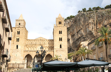 The Norman style Cathedral of Cefalu next to the rock of the same name, Sicily, Italy