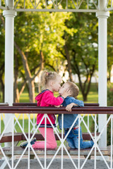 Love concept. Couple of kids loving each other hugging and kissing