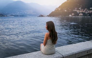 Young woman at the lake Como at sunset