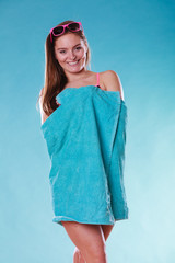 Happy young woman girl in swimsuit with towel.