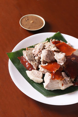 Lechon or suckling pig on a banana leaf. The food is popular in Span and former Spanish colonial regions especially prepared during festivals.