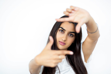Indian woman showing frame hand gesture