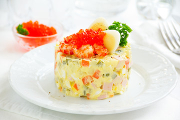 """Salad """"Olivier"""" with crayfish and caviar."""