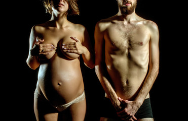 bearded slim man and pretty pregnant woman with round belly