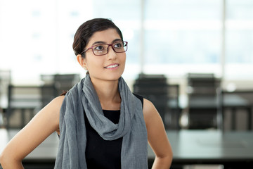 Portrait of smiling Asian businesswoman in glasses