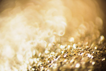 Fabulous winter bokeh of golden garlands. Abstract background. Christmas toy
