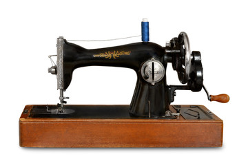 old sewing machine with manual drive on white isolated background
