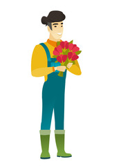 Asian farmer holding a bouquet of flowers