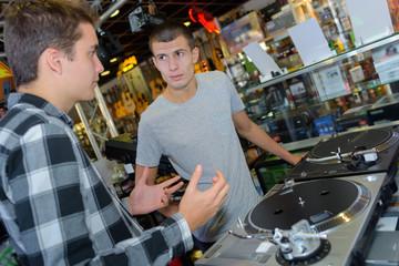 conversation in a disc jockey shop