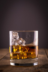 Foto op Aluminium Alcohol Glass of whiskey on wooden table