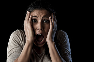 close up portrait young attractive Latin woman screaming desperate screaming in primal fear emotion