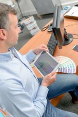 Designer using tablet computer