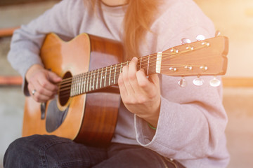 Musician playing guitar. Lens flare