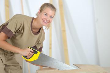Woman using handsaw