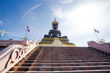 Black Buddha statue in plublic Temple Thailand