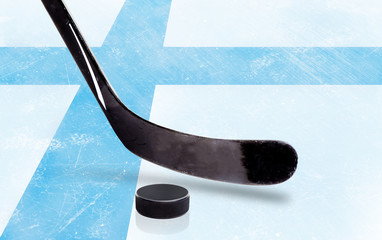 Hockey Stick and Puck With Finland Flag on Ice