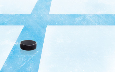 Hockey Puck and Finland Flag on Ice With Copy Space