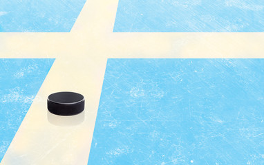 Hockey Puck and Sweden Flag on Ice With Copy Space