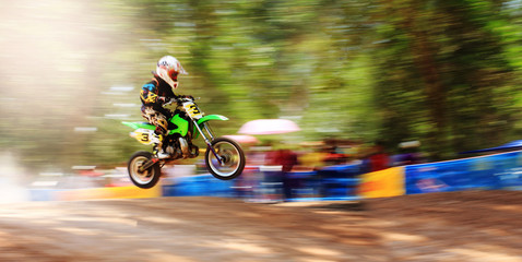 Motion blur of motocross Bike Jump,camera panning technique.