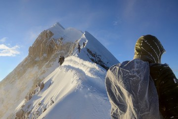 Sunrise over the stunning and deep boot pack along the ridge to the summit of Huayna Potosi
