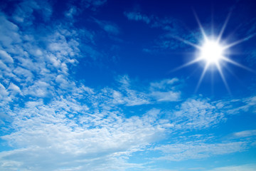blue sky and sun with white could