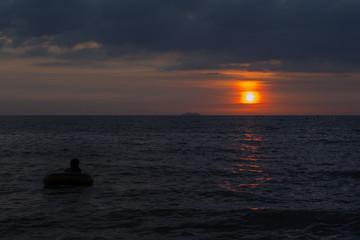Sunset sky with the sea low-key dark theme