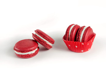 Red macaroons in polka dots muffin form isolated on white