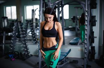 Beautiful girl sexy workout at gym