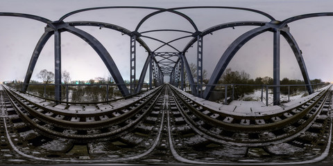 Full 360 degree equirectangula panorama night railway bridge