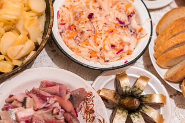 Country dinner with roast potatoes, smoked fish, bread and coleslaw