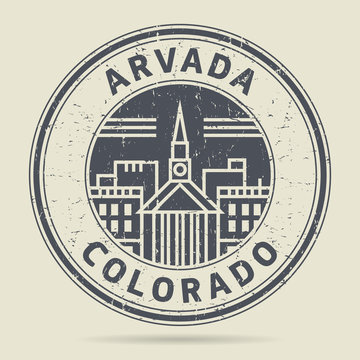 Grunge rubber stamp or label with text Arvada, Colorado