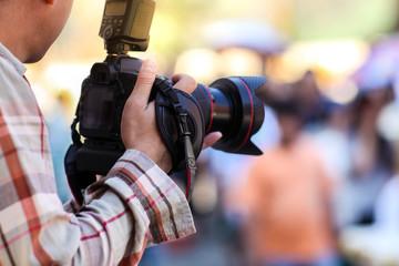 Photographer and digital camera.