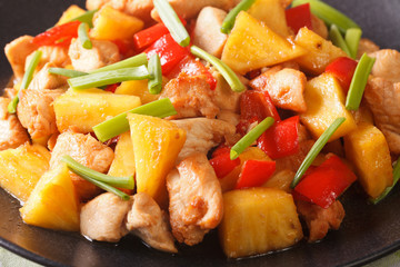 chicken breast with pineapple and vegetables in sweet and sour sauce macro. horizontal