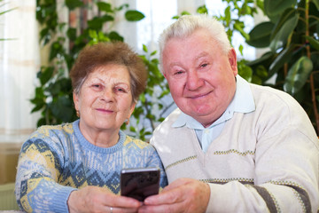 Cute senior couple taking a selfie