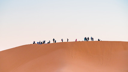 group of people in desert