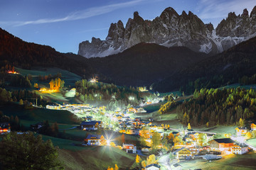 Wall Mural - Santa Magdalena Italian village at Funes rocks background. Dolomite alps, night scene.