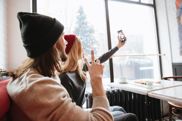 View from back of couple making selfie