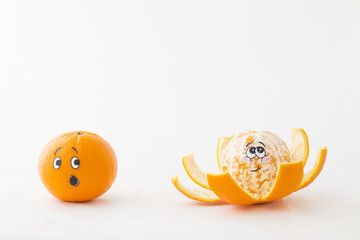 One tangerine with an astonished face and a peeled tangerine with blushing face in front of white background