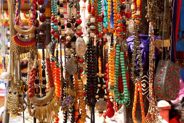 Artificial stones, pearls, beads rosary, bangles, purse hanging in a street shop