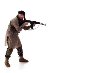 man in military outfit warrior Mujahedin in modern times on a white background in studio