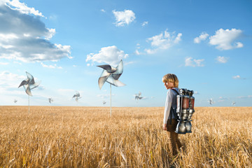 Boy in a field with propellers