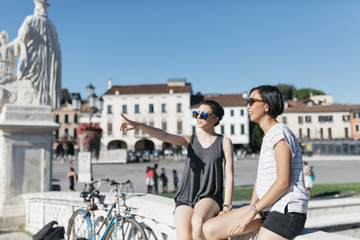 Italy Padua, two young women watching something