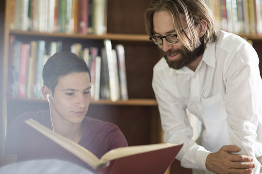 High school student in library with librarian