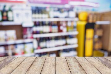 Wine shelves in supermarket blur background