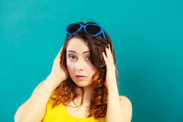 Girl in blue sunglasses portrait