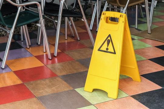 yellow label warning of slippery floor