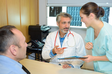 Medical staff with male patient