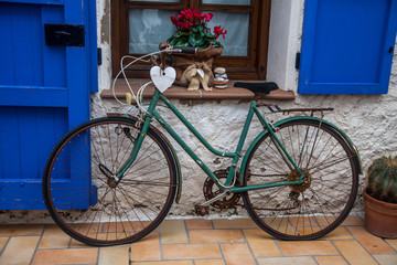 Vintage old bicycle in front of cute flowered house in Spain