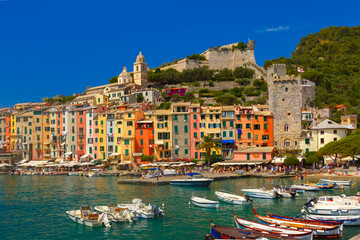 Fotobehang Liguria Colorful picturesque harbour of Porto Venere, San Lorenzo church and Doria Castle on the background, La Spezia, Liguria, Italy.