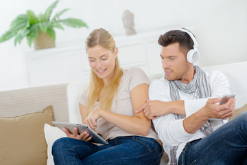 man and woman with gadgets